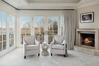 A view of the sitting area with french doors leading out to the balcony.