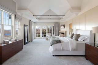 The master suite includes a gas fireplace, a balcony, and an enormous walk-in closet