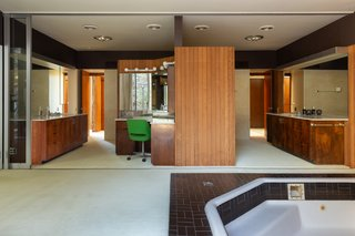 """The master bath has """"his and her"""" dressing rooms and a spa bath."""