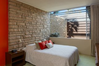 The third bedroom features a groovy stone inlay wall, which carries into the home from the exterior.