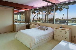 The second bedroom has views of the pool.