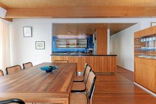 The open kitchen overlooks the dining area.