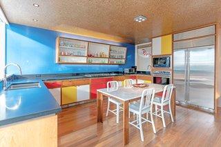 The kitchen offers modern conveniences but maintains a cool Bauhaus feel.