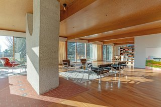 The living and dining areas are located in one large, open-plan space—which is typical of Breuer homes.