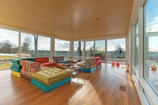 A second living room features expansive views of the beautiful surroundings.