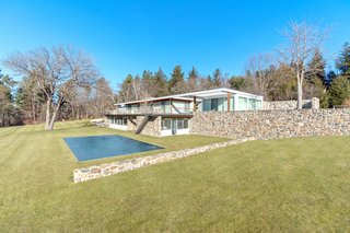 A long bluestone roof deck overlooks the pool and the expansive lawn.