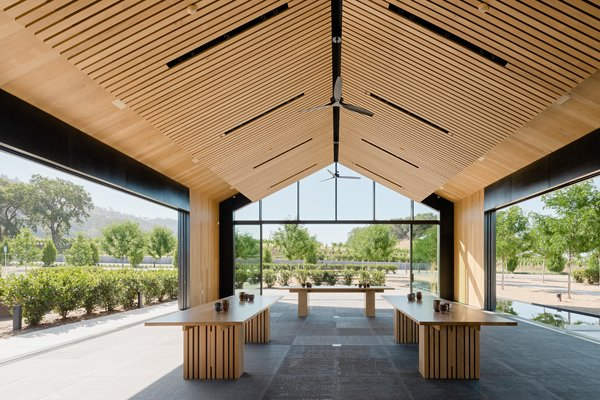 The indoor/outdoor structure embraces the wine-making process and provides a strong sense of space. The exterior wood is repurposed 100-year-old wine tanks.