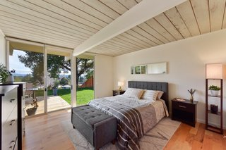 The master bedroom has sliding glass doors which lead to the backyard.