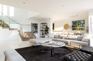 The open-plan living space is bright, white, and airy.