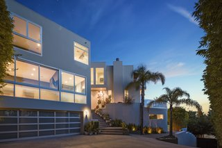 The villa's chunky rectangular forms set against a Los Angeles sunset.