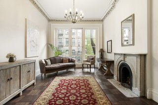 The townhouse's original fireplaces, detailed mantelpieces, stairwell, skylights, and moldings all remain intact.