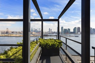"""The """"steel-framed cage of balconies"""" frames the skyline."""