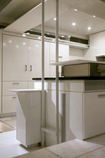 The chef's kitchen includes a Gaggenau six-burner stove, a Bosch dishwasher, and two Subzero refrigerators.