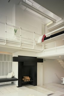 One of the highlights is the sleek, wood-burning fireplace.