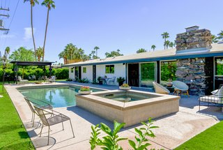 A new spa and a fully remodeled pool entertain guests outdoors.