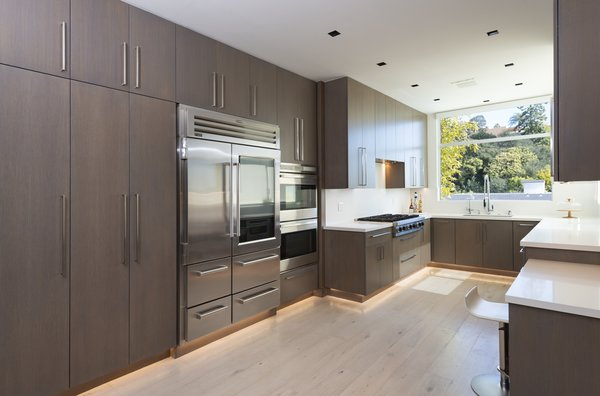 The updated chef's kitchen is bright and designed with lots of storage space to help maintain its streamlined modern look.