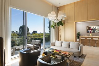 Glass sliding doors lead to an outdoor terrace with sweeping city views.