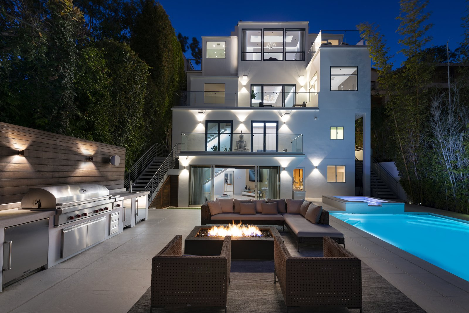 The home at night. Note the high privacy hedges that rim the outdoor space.