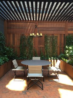 The ivy-covered terrace has three access points from inside the apartment.