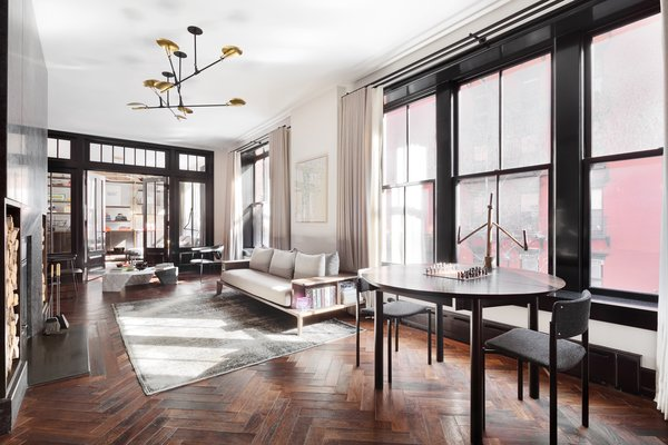 The baseboards, casings, windows, and doors are trimmed in Roman & Williams' favorite high gloss black oil paint by Fine Paints of Europe.
