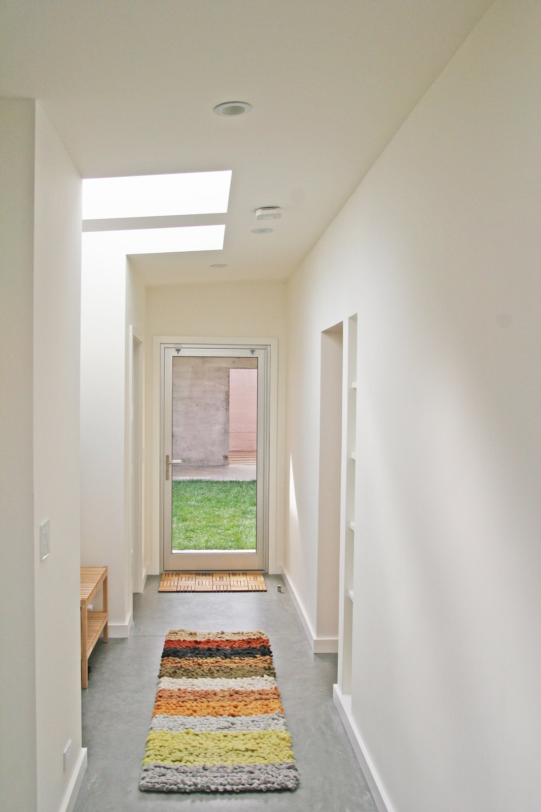 Hallway and Concrete Floor  Shotwell Residence by Todd Davis Architecture