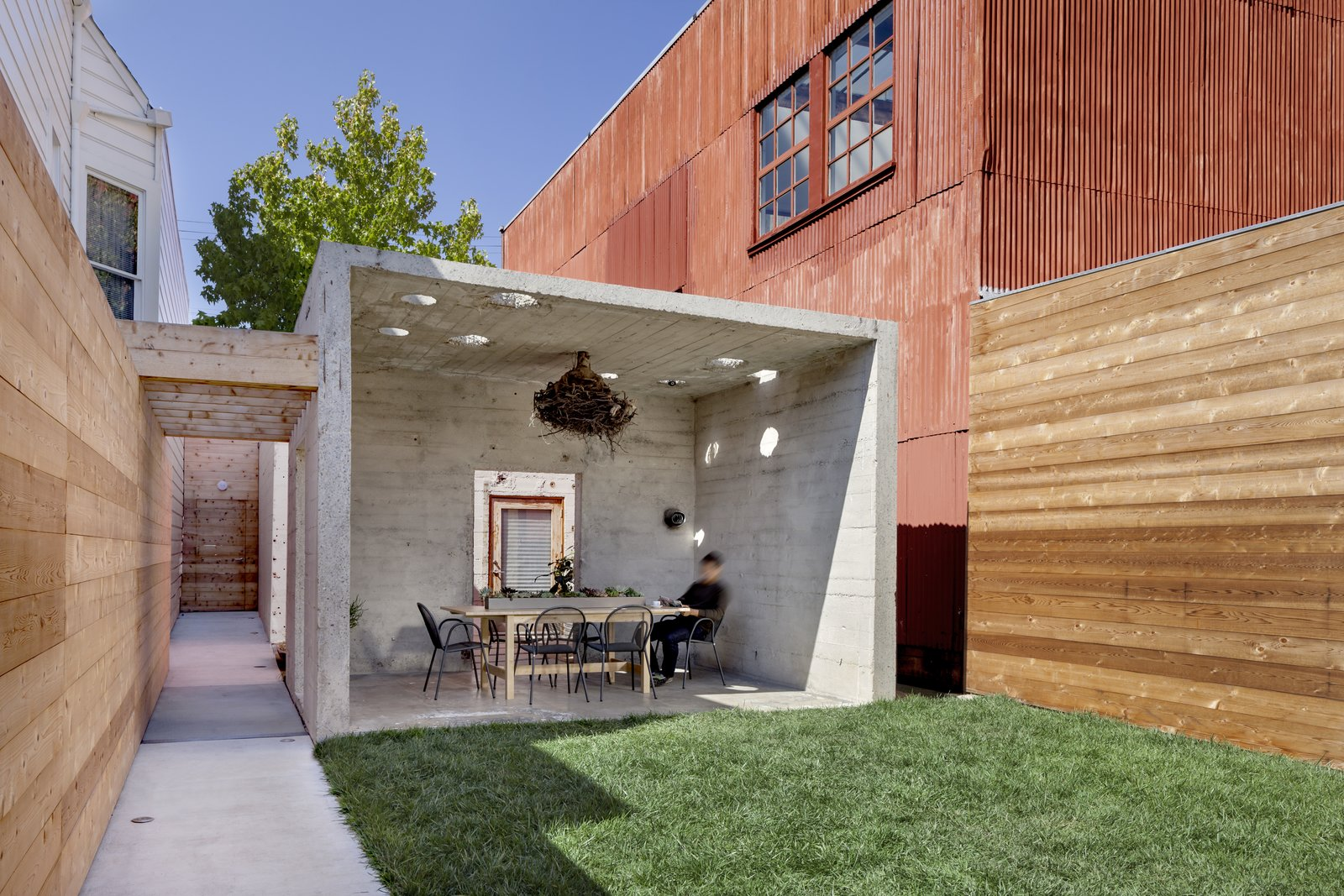 Dining Room, Table, Chair, and Concrete Floor  Shotwell Residence by Todd Davis Architecture