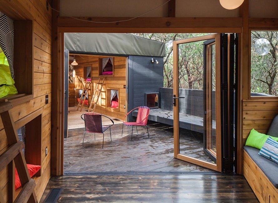Bedroom, Bed, Pendant Lighting, and Dark Hardwood Floor  Forest House