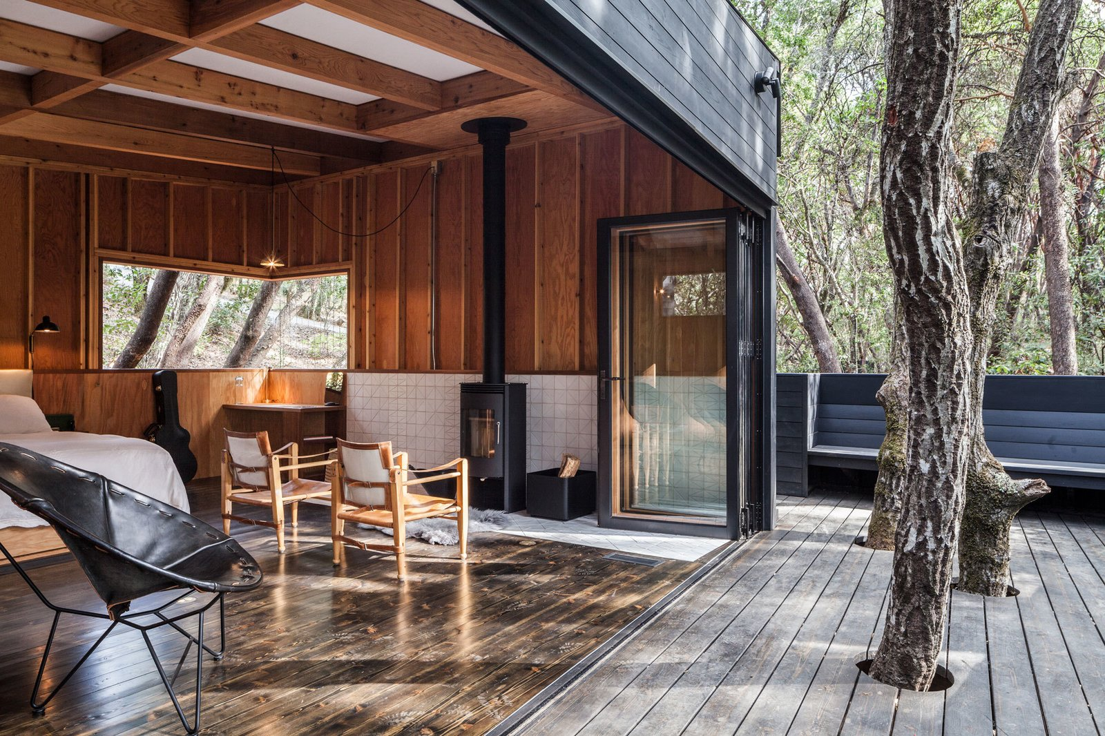 Doors, Exterior, Wood, and Folding Door Type  Photo 3 of 6 in Top 5 Homes of the Week That Welcome the Outdoors In from Forest House