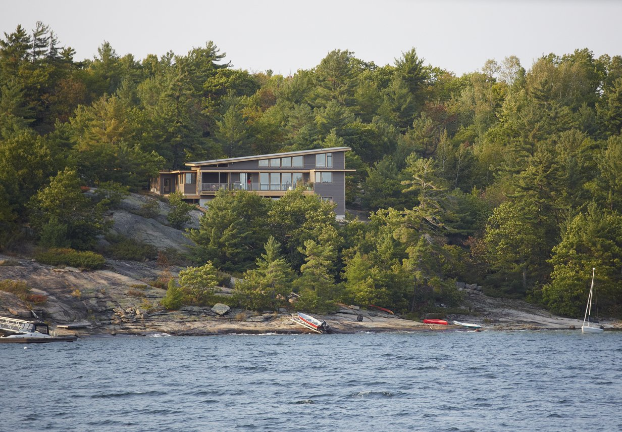 Exterior, House Building Type, and Prefab Building Type  Photo 3 of 6 in Turkel Design's Georgian Bay House Energy Conscious in the Canadian Shield