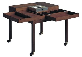 A storage table for pipes and tobacco designed by the duo for King Frederik IX of Denmark.