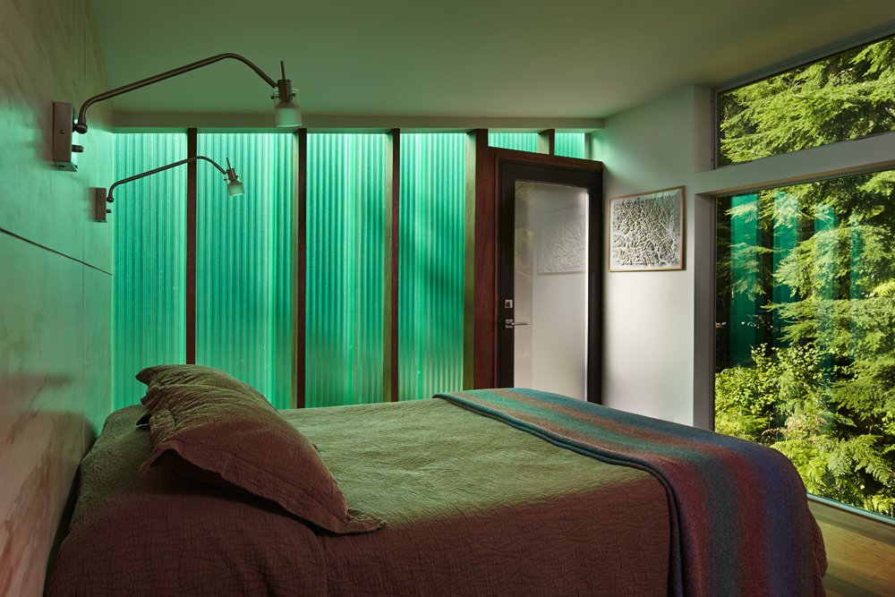 Bedroom, Bed, Wall Lighting, and Medium Hardwood Floor  Bear Run Cabin by David Coleman / Architecture
