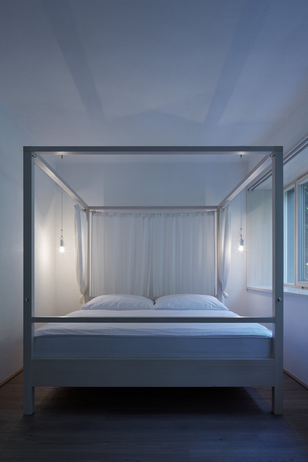 Bedroom, Bed, Pendant Lighting, and Medium Hardwood Floor  Best Photos from House by the Forrest