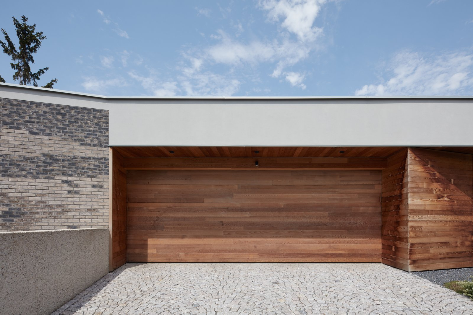 Garage and Attached Garage Room Type  Villa H by BoysPlayNice Photography & Concept