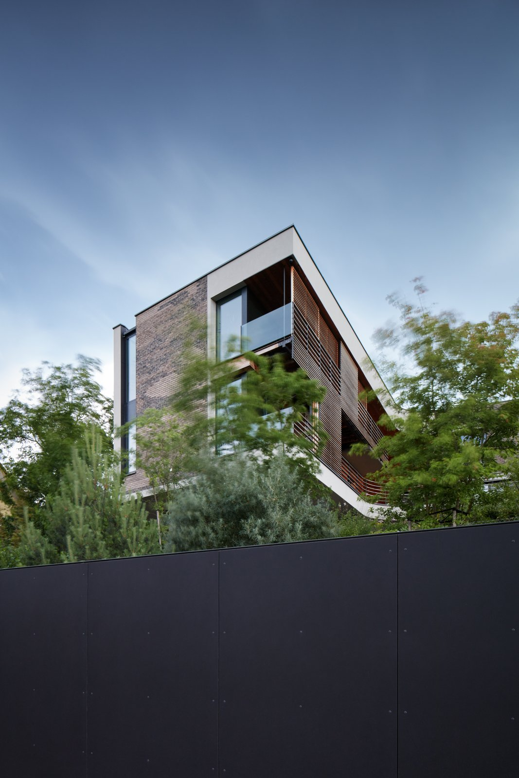 Outdoor, Trees, and Metal Fences, Wall  Villa H by BoysPlayNice Photography & Concept