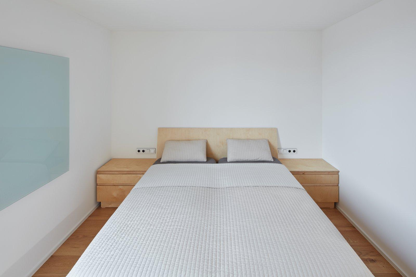 Bedroom, Ceiling Lighting, Bed, Night Stands, and Medium Hardwood Floor  Freedomek No.061 by BoysPlayNice Photography & Concept