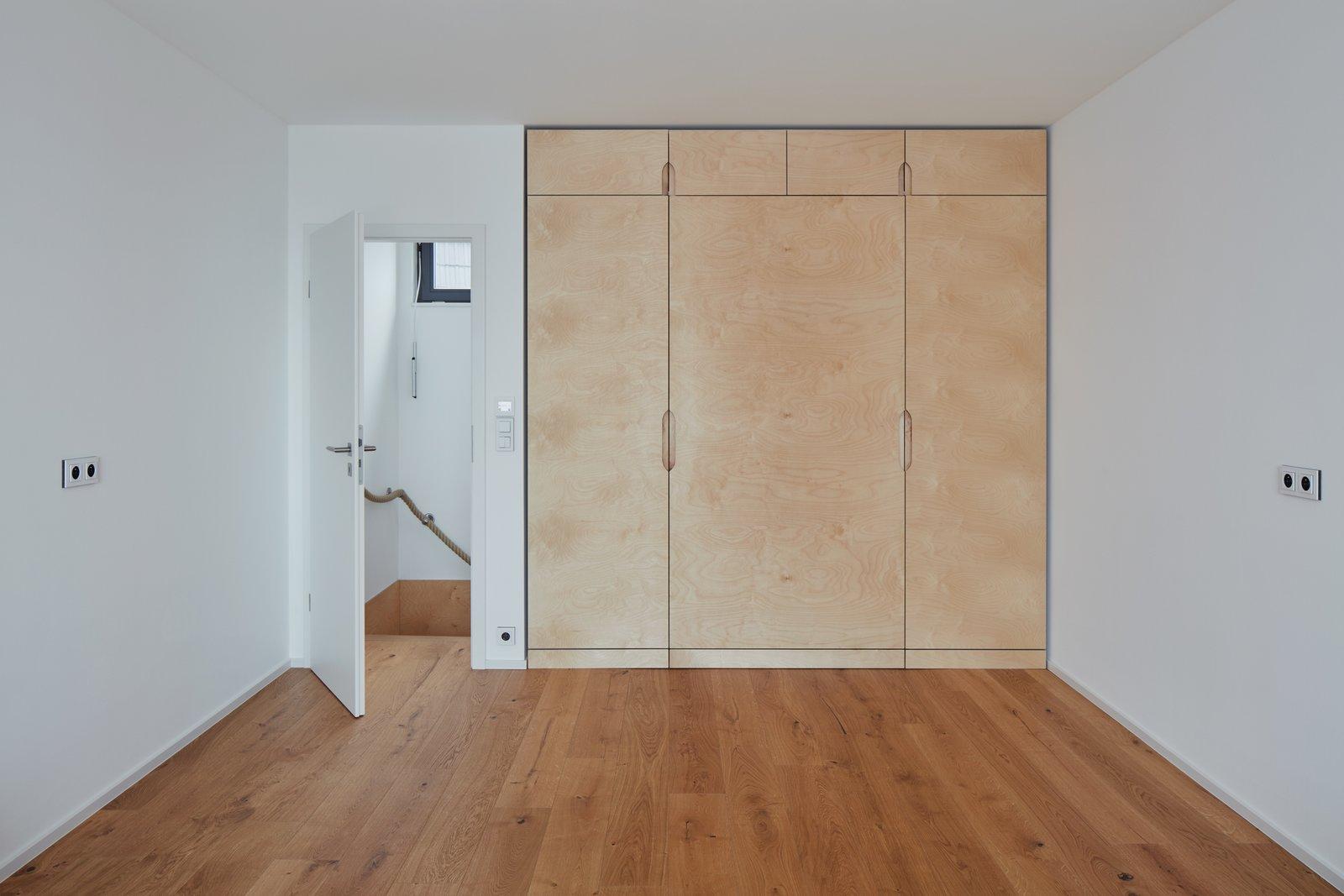 Bedroom, Wardrobe, Bed, Ceiling Lighting, and Medium Hardwood Floor  Freedomek No.061 by BoysPlayNice Photography & Concept