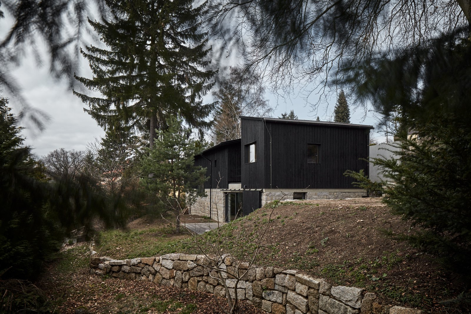 Exterior, Shed RoofLine, Glass Siding Material, Stone Siding Material, Wood Siding Material, Concrete Siding Material, and House Building Type  House Behind the Wall by BoysPlayNice Photography & Concept