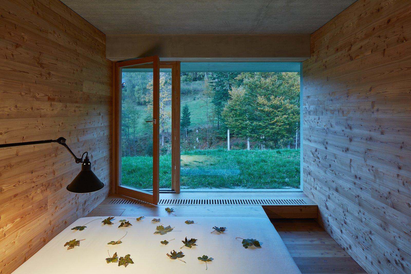Bedroom, Bed, Wall Lighting, and Medium Hardwood Floor  Photos from Weekend House in Beskydy