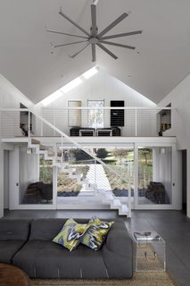 An open mezzanine allows for hot air to rise, and a ceiling fan helps circulate out the hot air.