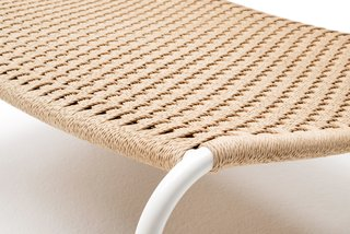 Detail of the 'Cellulosa Frog' armchair, which features a woven two-thread cellulose cord over a painted steel frame.
