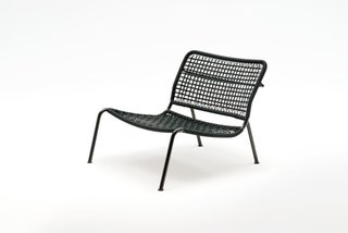 The 'Carbon Frog' armchair by Living Divani. With a carbon fibre frame and a nylon woven seat, it's remarkably light.