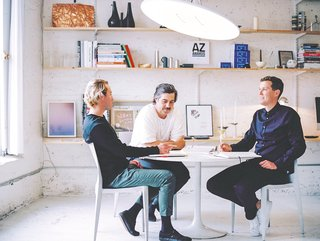 Heintzman, Davis and Peet sit beneath a Button light in the ANDlight studio. All ANDlight products are designed and hand-assembled in their industrial Vancouver workspace, originally built as a stable in the early century.