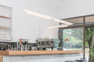 Pipeline — Design, Caine Heintzman<br><br> The Pipeline's modular design allows endless shaping possibilities. It has a dimmable, linear LED bulb housed in either a black, white, polished aluminum, or copper finish.