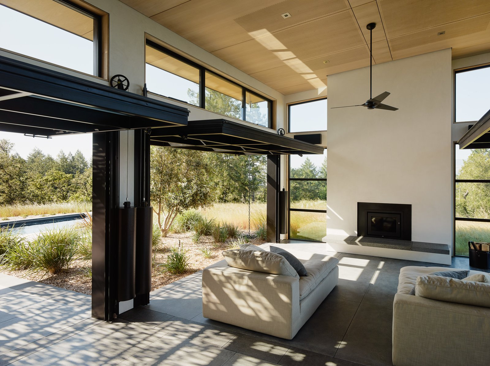 Living Room, Standard Layout Fireplace, Sofa, Recessed Lighting, and Concrete Floor  Photo 2 of 6 in Top 5 Homes of the Week That Welcome the Outdoors In from Sonoma Wine Country I