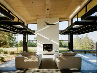 Glazed garage doors by Renlita lift up to completely open the home to nature.
