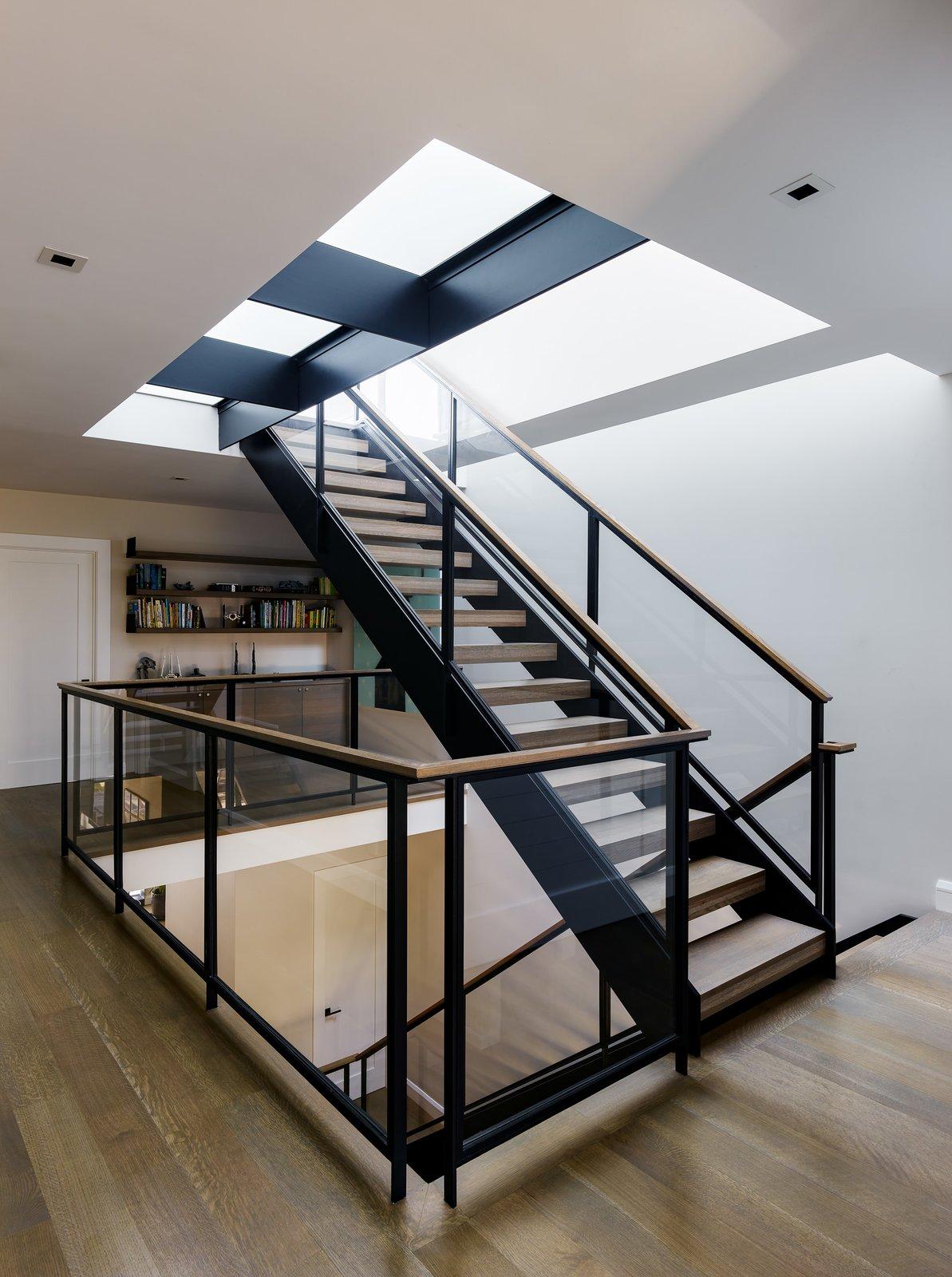 Staircase, Wood Tread, Metal Railing, Glass Railing, and Wood Railing  Noe Valley III by Feldman Architecture