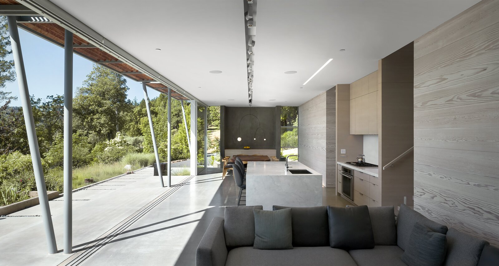 Living Room, Concrete Floor, and Sofa  Photo 9 of 11 in A Minimalist House Stands Out in a Wild Landscape from Sunrise