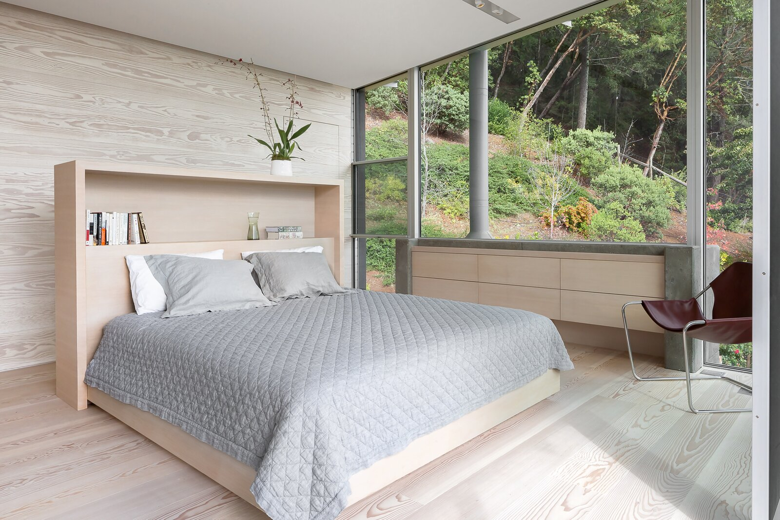 Bedroom, Light Hardwood Floor, Bed, and Dresser  Photo 10 of 11 in A Minimalist House Stands Out in a Wild Landscape from Sunrise