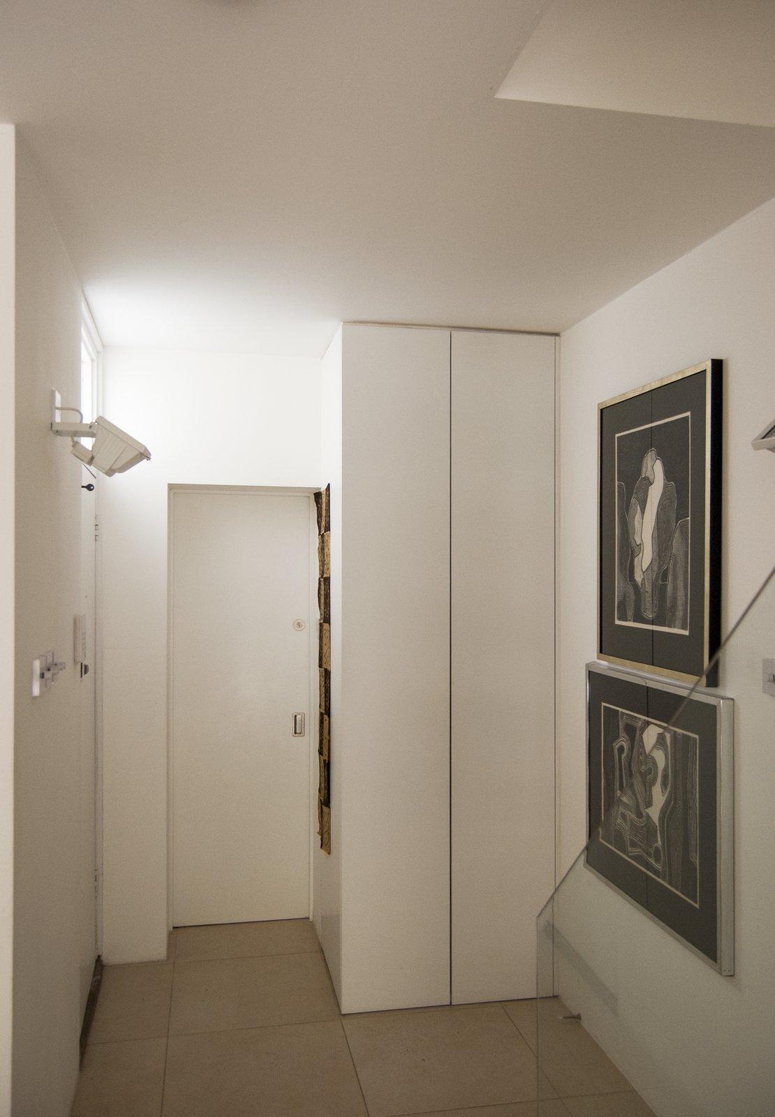 Ceramic Tile Floor, Staircase, Wood Tread, and Glass Railing  Soupçon Brut by WILLIAM TOZER Associates
