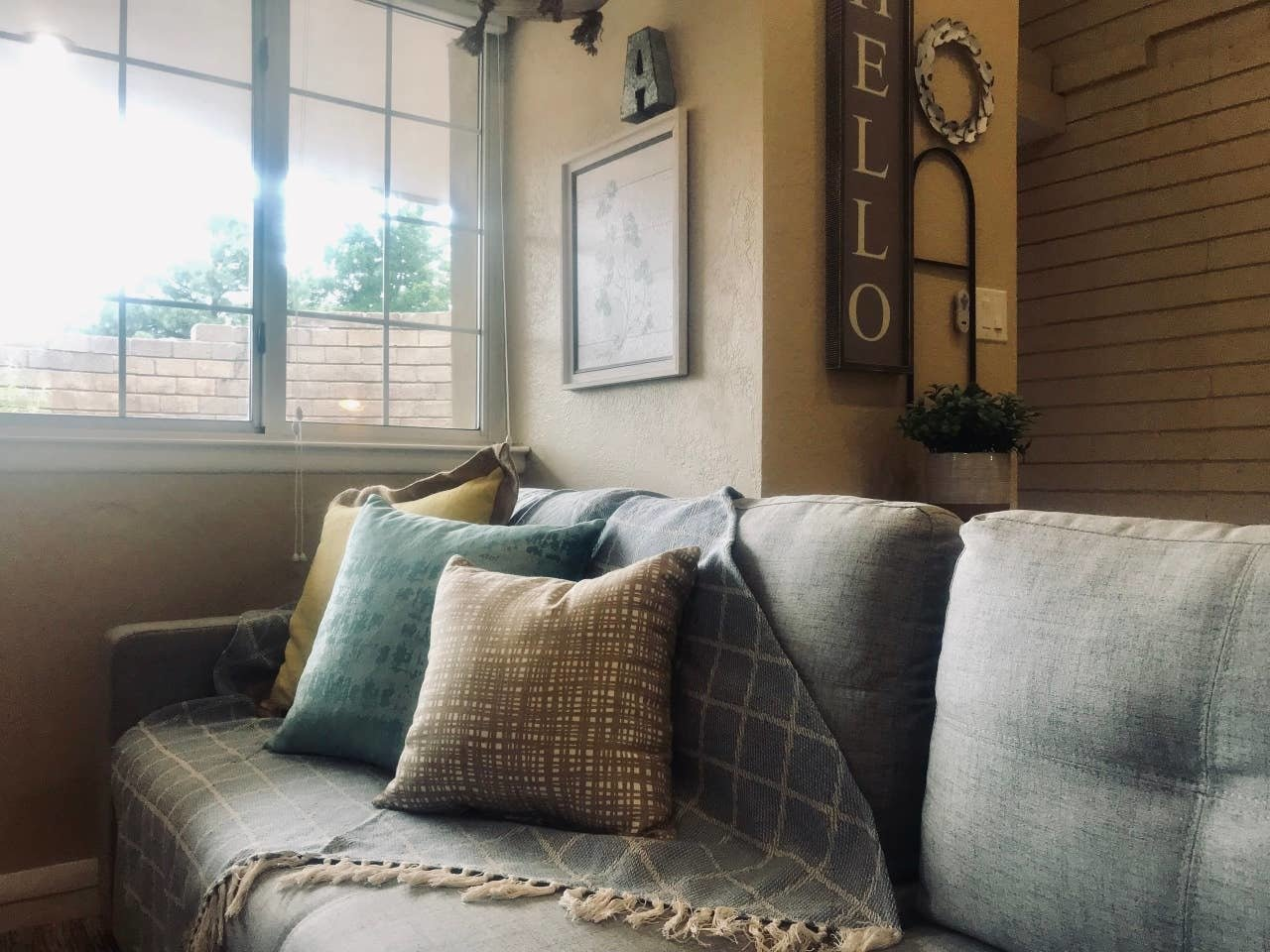 Living Room, Sectional, and Ceramic Tile Floor  Nakomis Dwellings